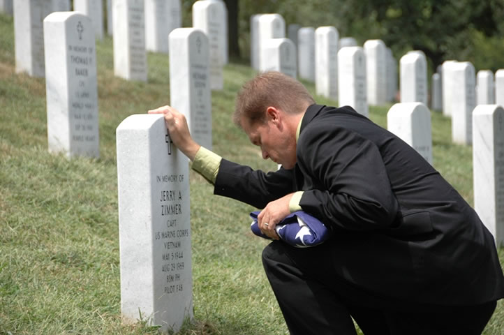 Craig Zimmer at Father's grave marker at Arlington