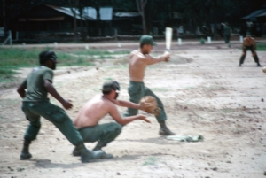 Soldiers play softball at 1st Infantry Division base camp, Lai Khe Vietnam