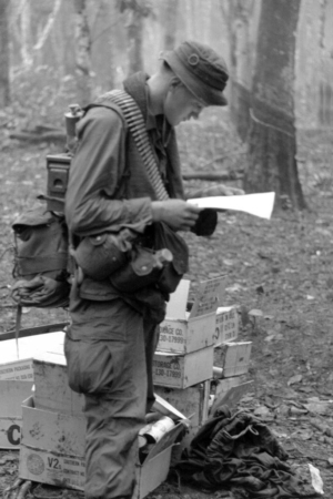US soldier in Vietnam reads letter from home