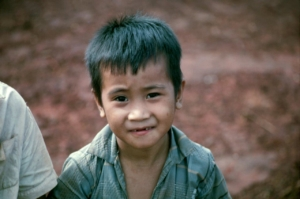 Vietnamese boy looks at camera