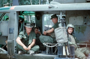 Company command groups waits in Huey to start mission